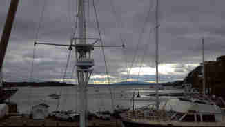 Voyager crew member goes up the mast in Castine, Maine