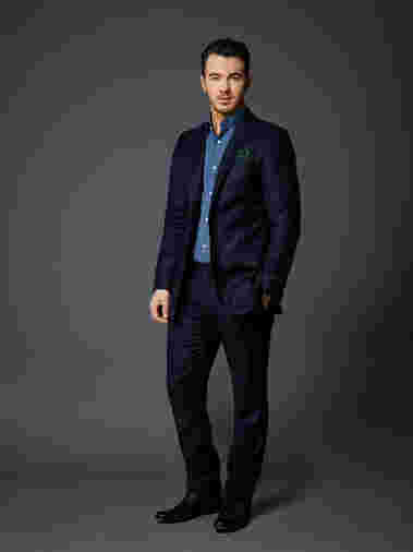 Kevin Jonas strikes a pose as cast for Celebrity Apprentice 2015.