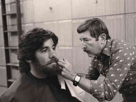 Geraldo Rivera gets a beard glued on, preparing for an investigation into the availability of drugs.