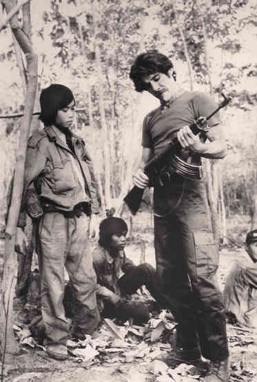 Geraldo inspects a rifle while on assignment for 20/20 in Laos, 1979.