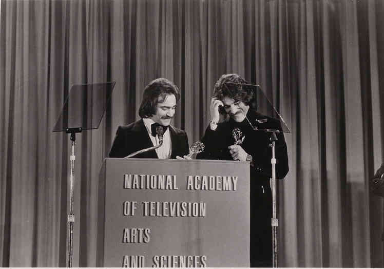 Geraldo Rivera and producer Martin Berman receive awards during the 1974 Emmys.