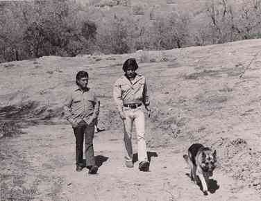 Geraldo and man take a walk with a shepherd