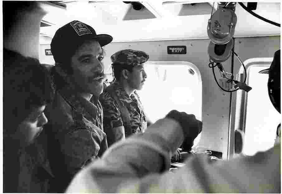 Vintage Geraldo shot with foreign troops in aircraft