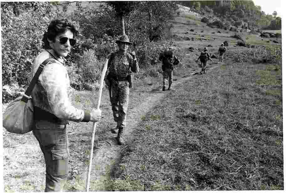 Geraldo walks a path with foreign troops, circa 1970s