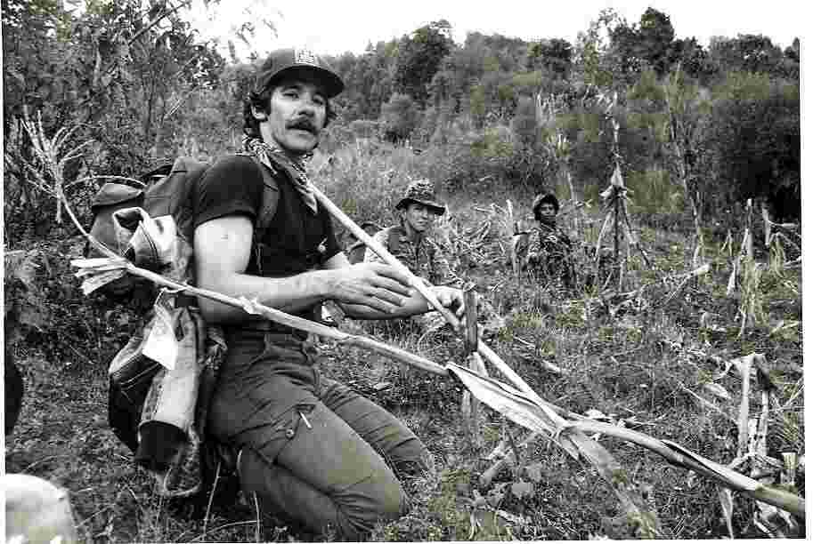 Geraldo crouches on the hillside, circa 1970