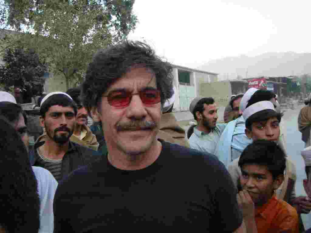 Geraldo close up with local youths in the background