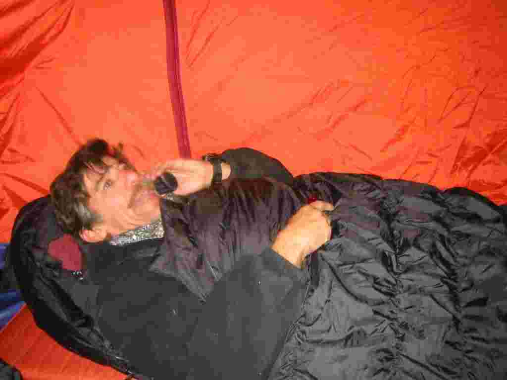 Geraldo talks on the phone in a sleeping bag during coverage.