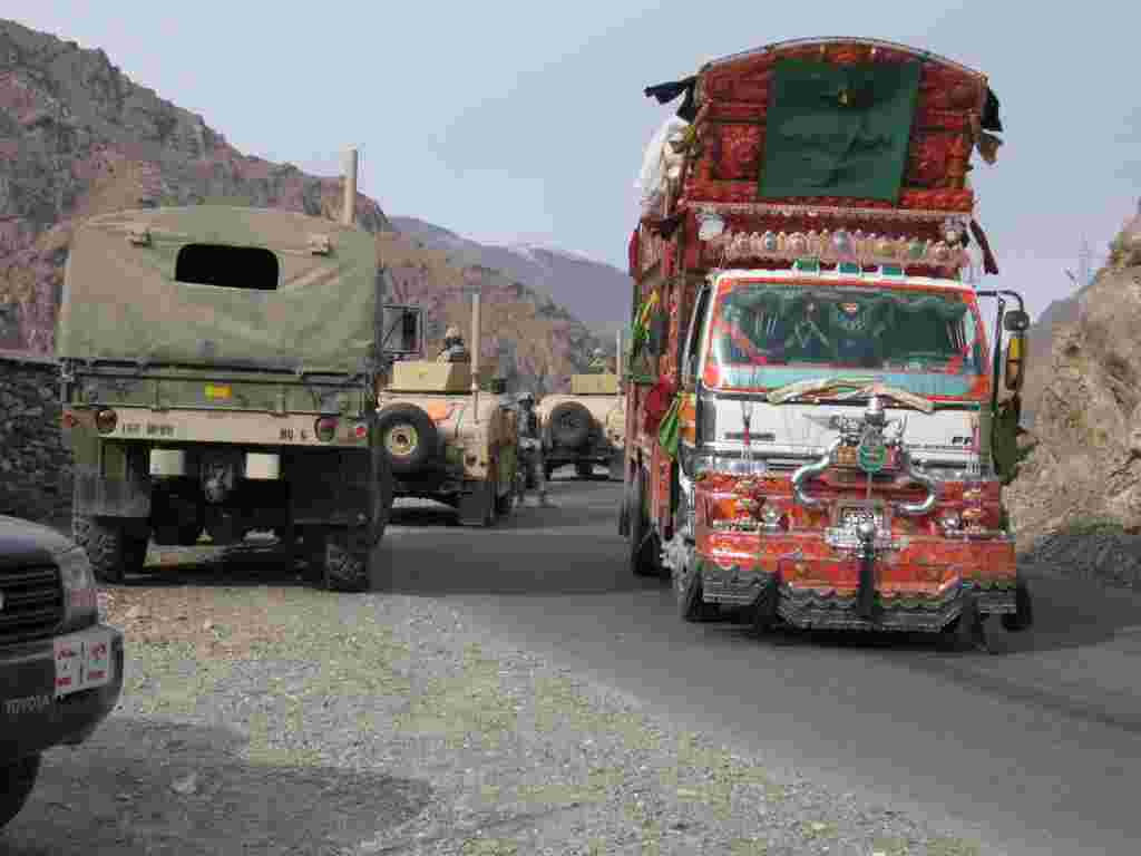 A custom rig passes coalition convoy