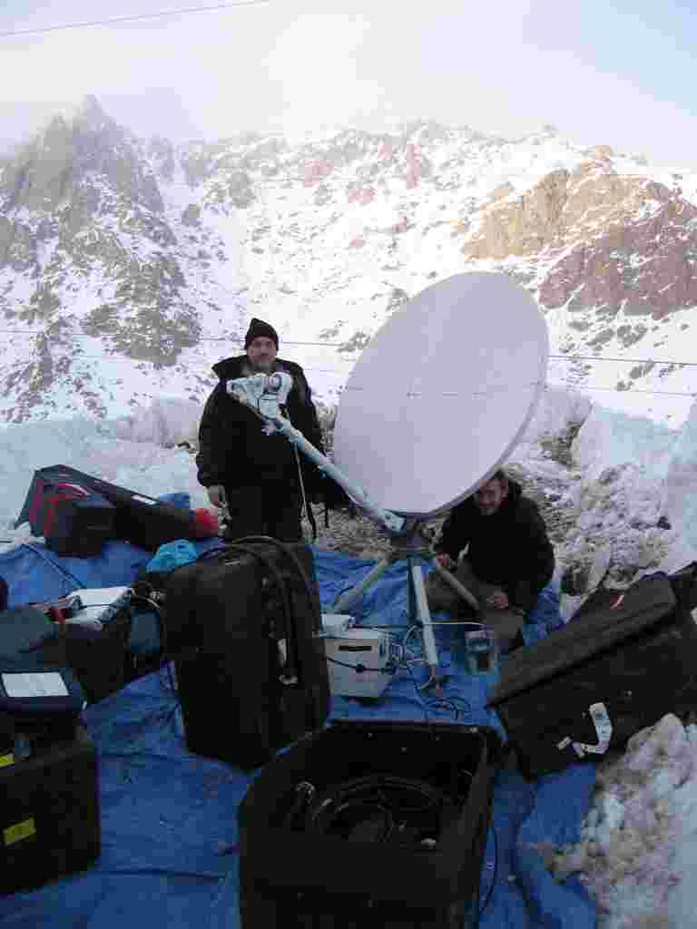 The crew sets up the satellite for a live show