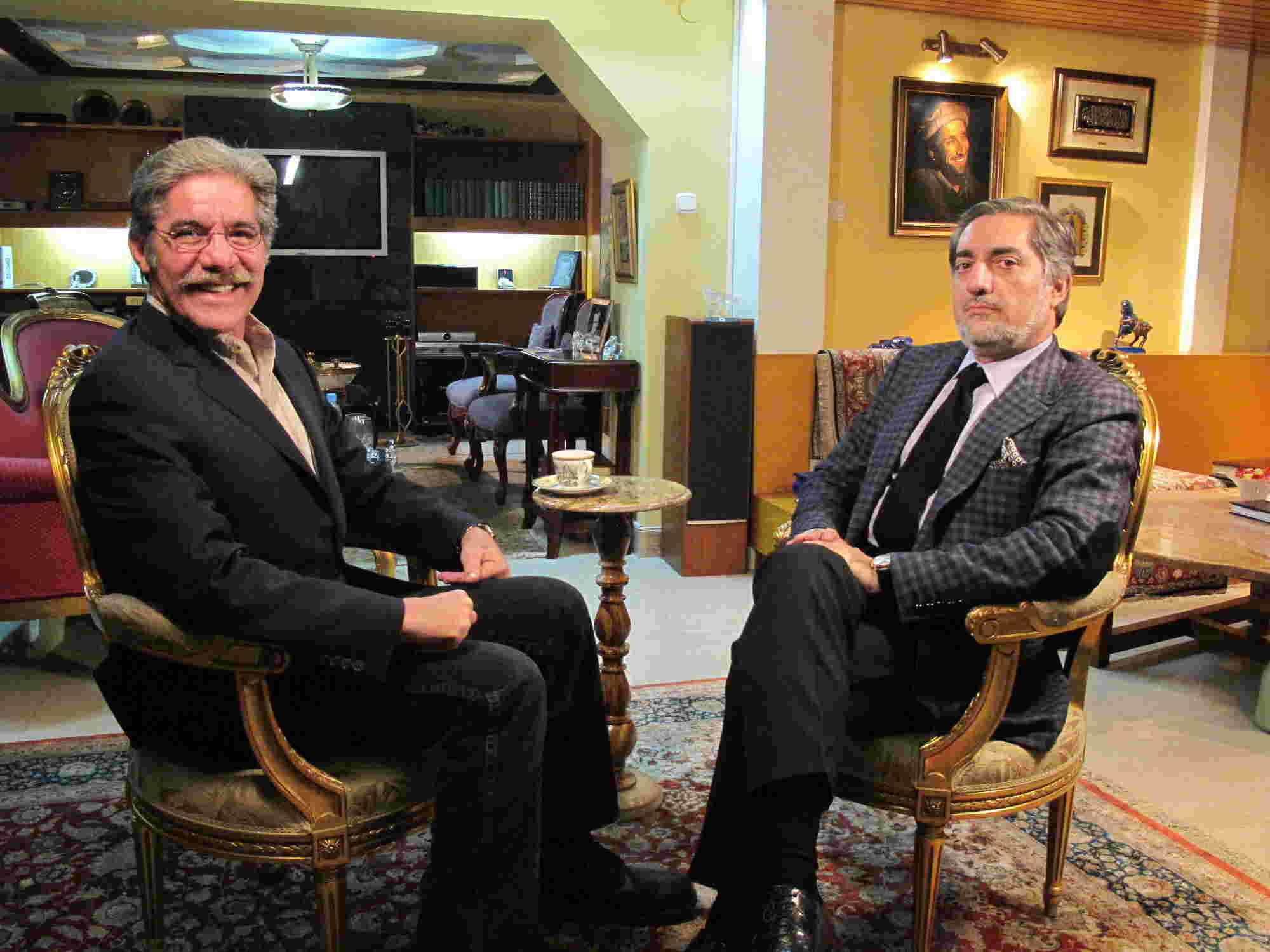 Geraldo and guest face the camera during an interview