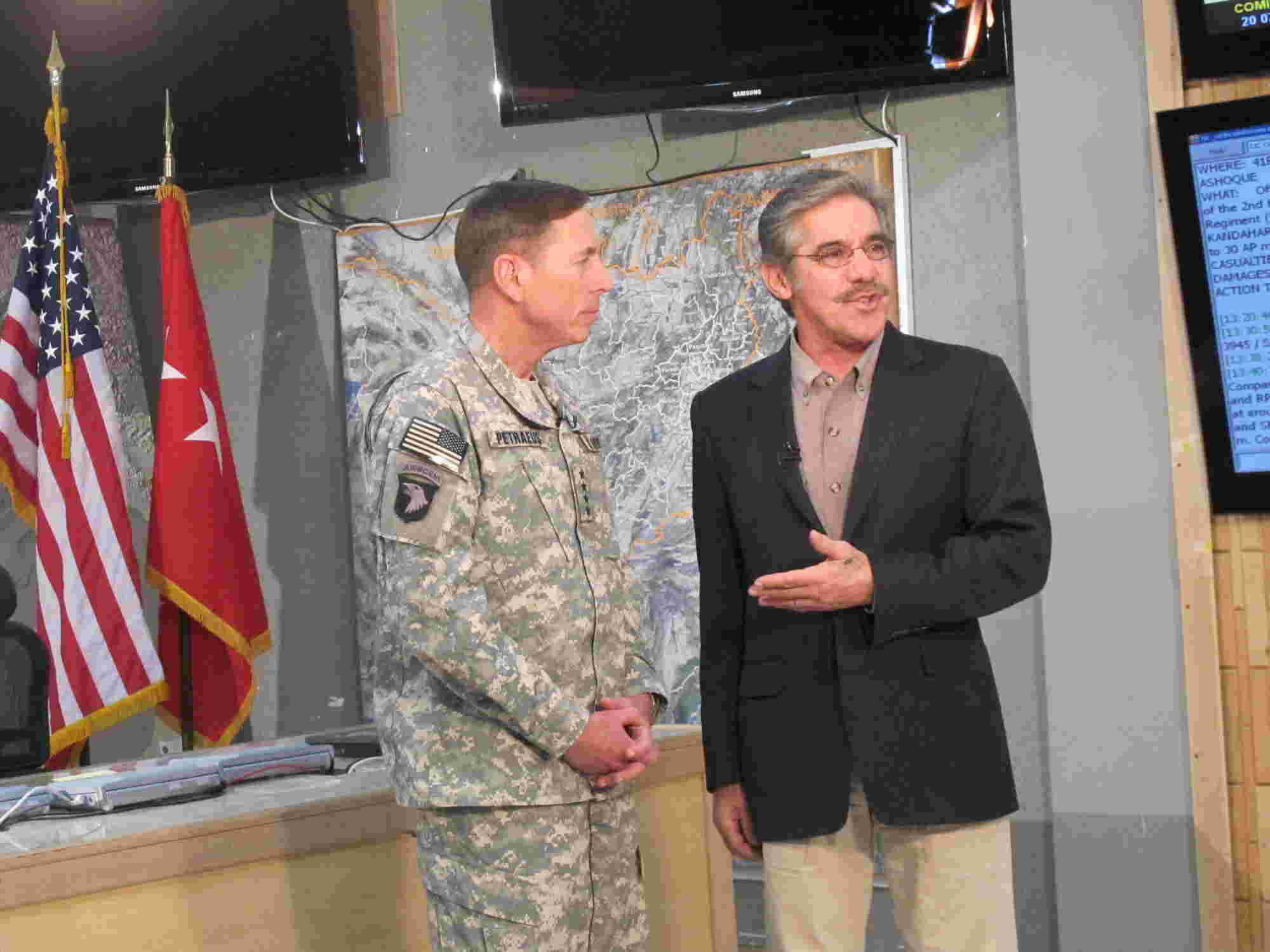 Geraldo stands with General David Petraeus, with combat map in the background