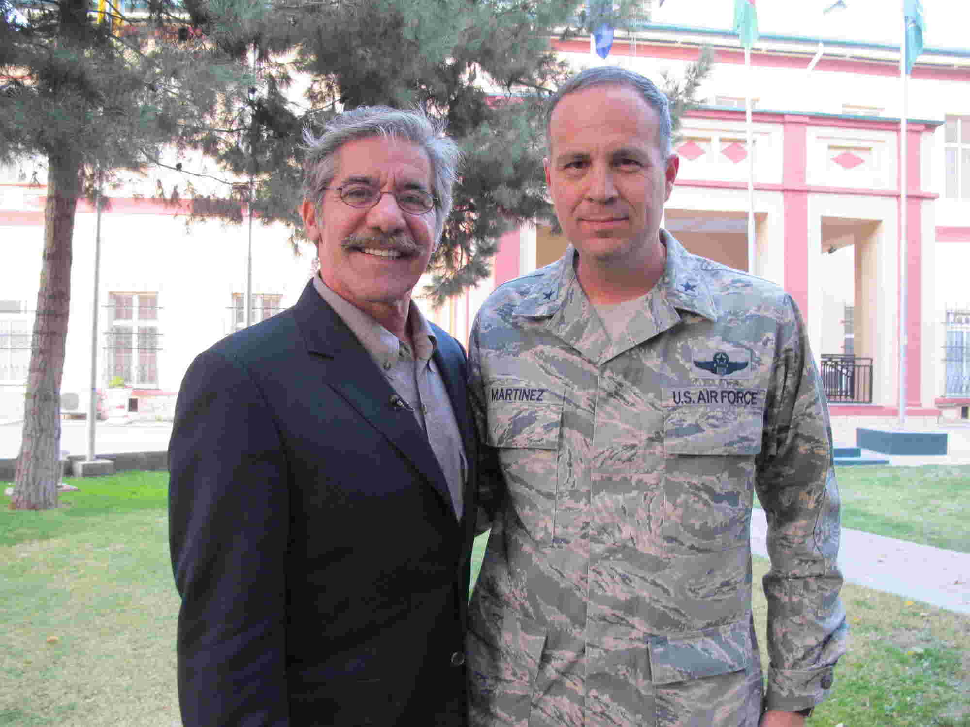 Geraldo poses with major General Jerry P Martinez, U.S. Air Force