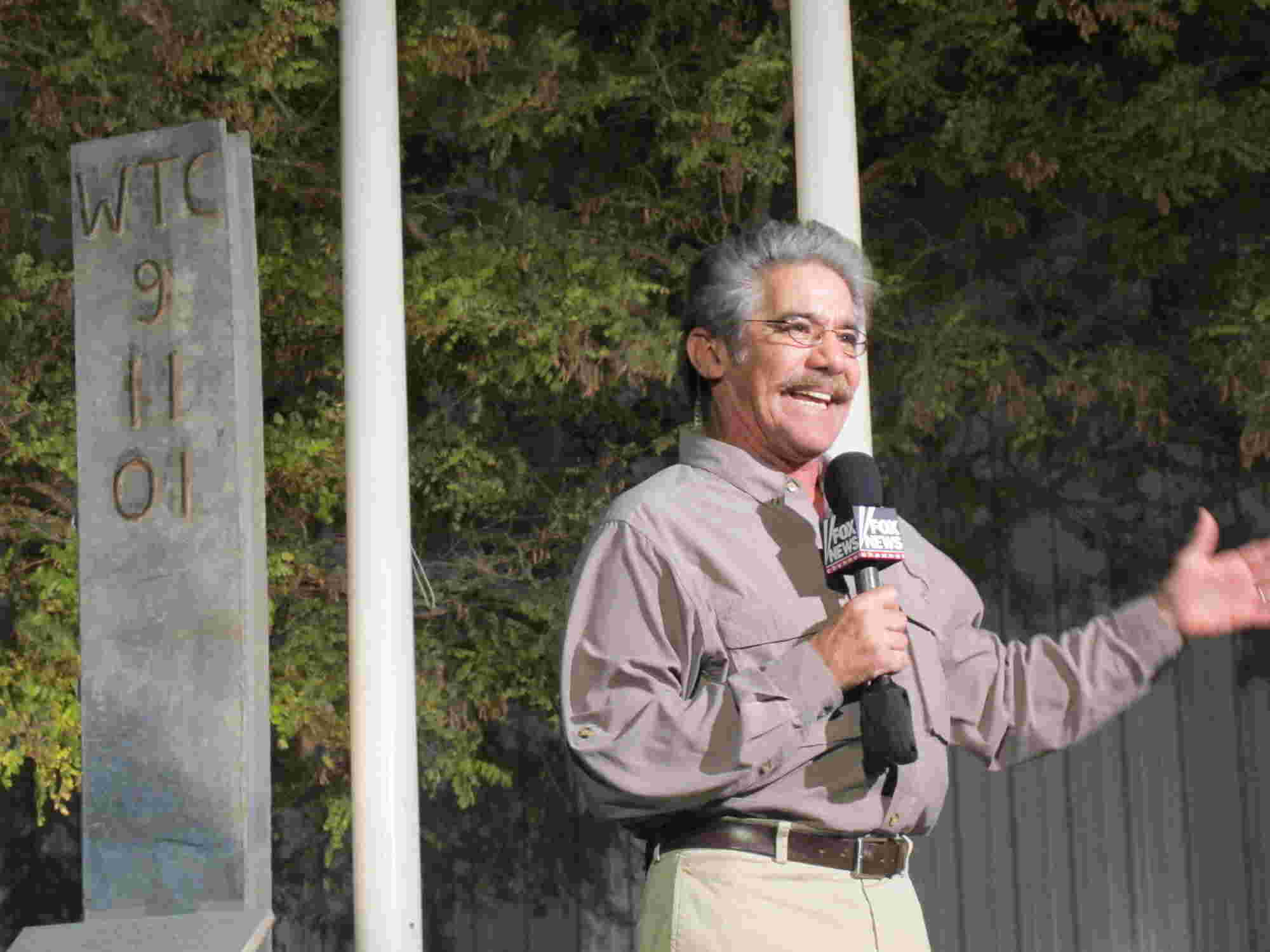 Geraldo speaks in from of a monument memorializing 09/11