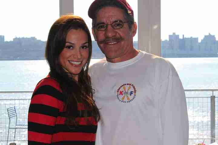 Geraldo poses with wife Erica, in front of the slider at their home in Edgewater New Jersey.