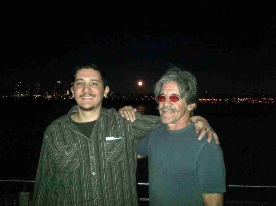 Geraldo and his oldest son Gabriel Rivera in front of an evening moon