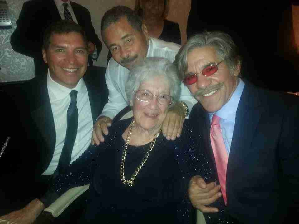 Geraldo shares a formal moment with, left to right, brothers Craig Rivera, Willy Rivera and mother Lillian