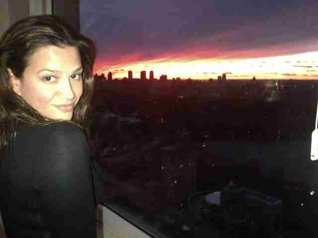 Wife Erica Rivera looks on during a sunset in Manhattan