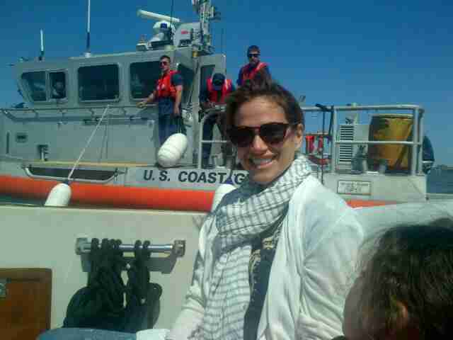 Erica poses on board while U.S. Coast Guard vessel rides on