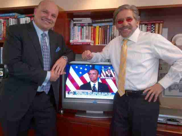 Geraldo poses with his friend and colleague Arthur Aidala, Attorney At Law, as a televised Barack Obama looks on