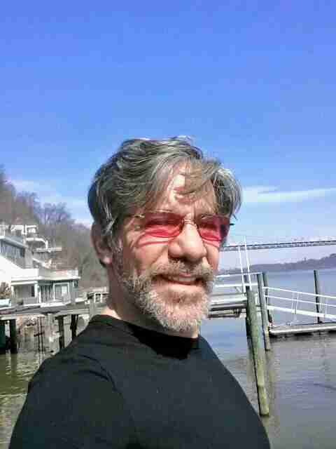 Geraldo takes a selfie on the dock with the George Washington bridge in background