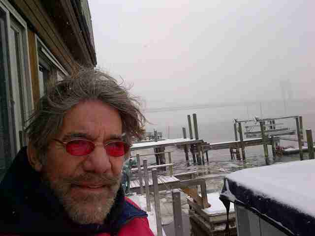 Geraldo down on the dock during a cold, icy winter in Edgewater, New Jersey with the George Washington bridge just visible in the background.