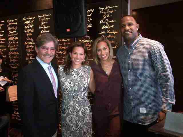 Geraldo and wife Erica take a pic with some friends while out to eat.