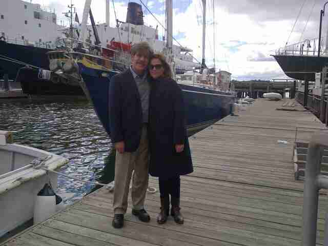 Geraldo and wife Erica share a picture in front of sailing vessel Voyager, after donating her.