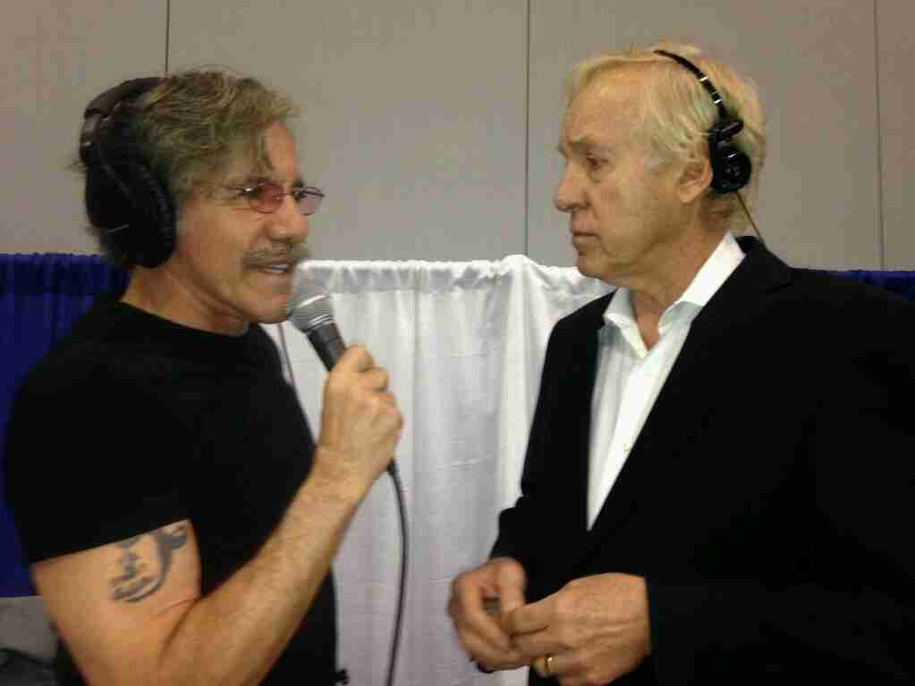 Geraldo with a guest during a radio job fair in partnership with Cumulus and iHeart Radio, circa 2014.