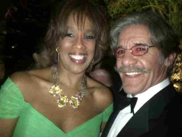 Geraldo snaps a quick pic with his friend.