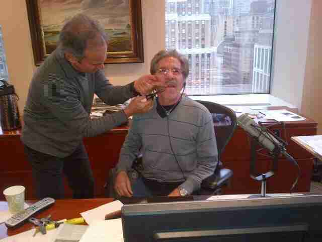 Producer Martin Berman trims the mustache on air during Geraldo's live 77 WABC radio show, in studio high above Madison Square Garden, New York City.