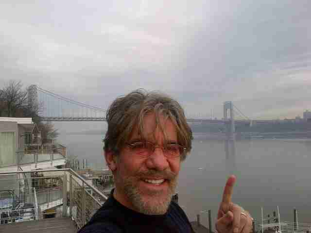 Bearded Geraldo in Edgewater, New Jersey, with a foggy George Washington Bridge in the background.  Circa 2014.