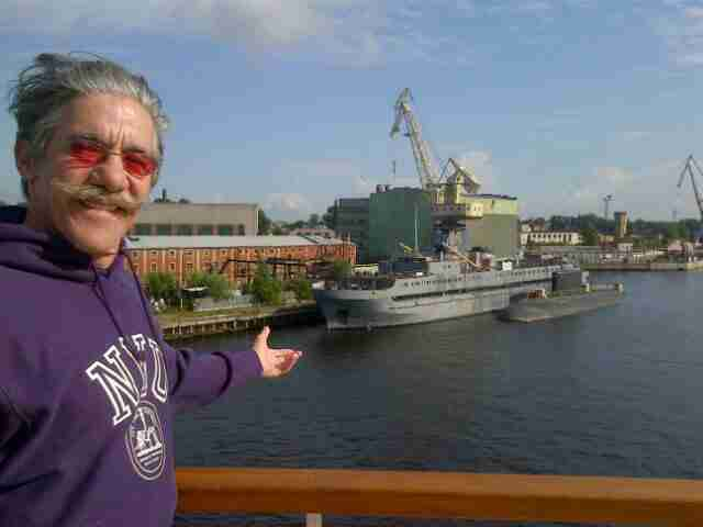 Geraldo gestures to some big ships.