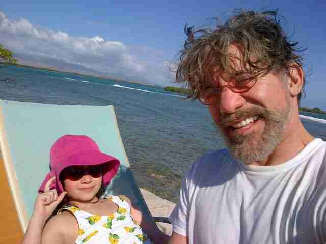 Geraldo catches some rays with his youngest daughter Sol, on island near Salinas, Puerto Rico.