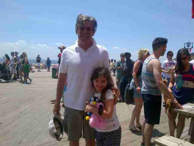 Geraldo at the beach with his youngest daughter Sol.
