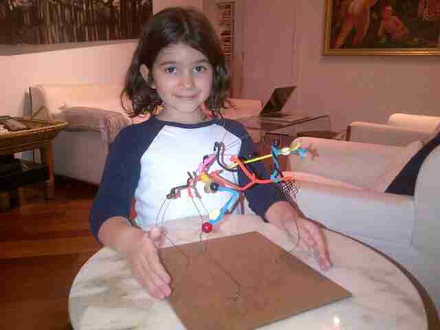 Geraldo's youngest daughter Sol with her project.