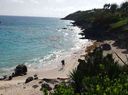 Crew member walks the Bermuda beach, after Voyager completed the Marion to Bermuda sailing race in 2013.