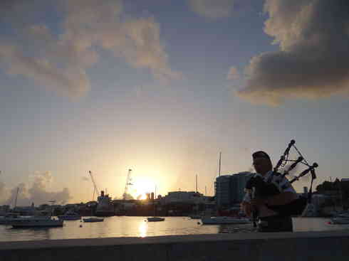 Bagpipes on the docks at the Royal Hamilton Amateur Dinghy Club, during sunset in Bermuda.  Taken by Voyager crew after completing the Marion to Bermuda sailing race in 2013.