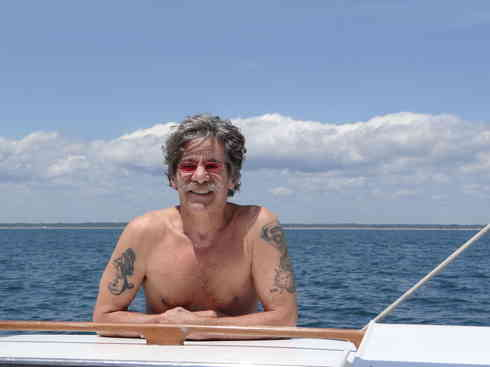 Geraldo takes some sun aboard Voyager during the Marion to Bermuda sailing race, 2013.