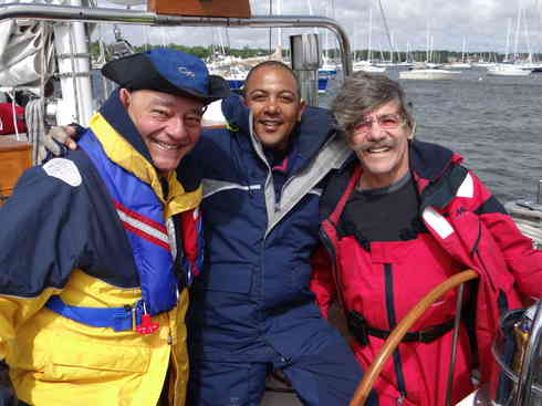 Crew members Dr. Guillermo, Captain Kevin and Geraldo prior to departing Marion Harbor for the Marion to Bermuda race 2013.