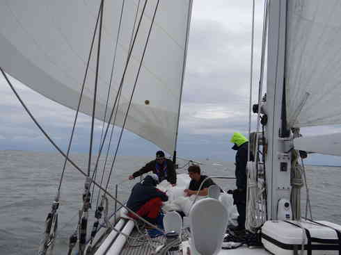 Voyager crew stows the sail after a change en route to Bermuda during the Marion to Bermuda sailing race in 2013.