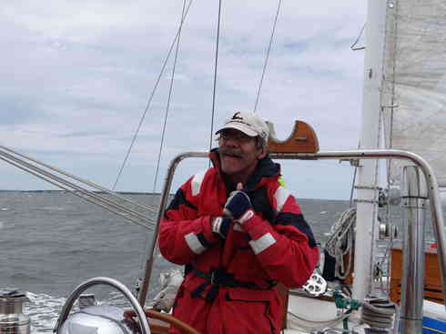 Geraldo preps for the weather on board Voyager, during the Marion to Bermuda sailing race in 2013.