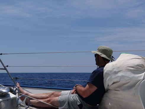 Crew member Ross takes in some sun aboard Voyager, during the Marion to Bermuda race in 2013.