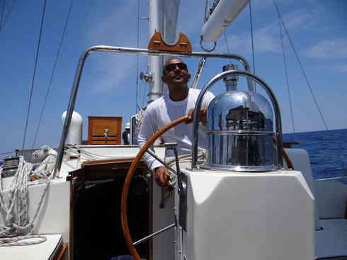 Captain Kevin takes the helm of Voyager, during Marion to Bermuda sailing race in 2013.