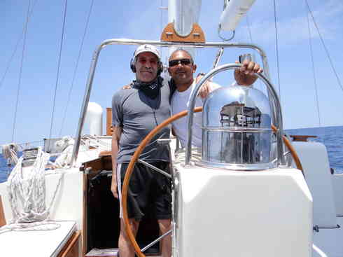 Skipper Geraldo and Captain Kevin at the helm of Voyager, during the Marion to Bermuda 2013 sailing race.