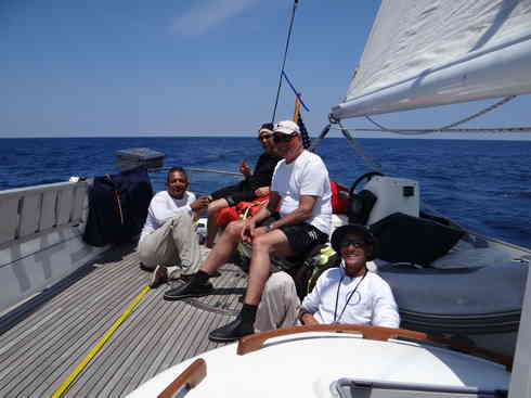 Voyager Crew takes a moment on the aft deck.  From left is Kevin, Greg, Guillermo, Larry.  Taken during the Marion to Bermuda sailing race, 2013.