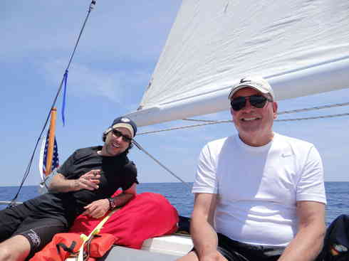 Greg (left) and Guillermo take a moment on the aft deck of Voyager.  Taken during the Marion to Bermuda sailing race in 2013.