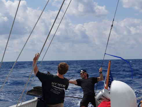 Crew members Forrest and Greg duel for lunch rights aboard Voyager.  During the Marion to Bermuda 2013 sailing race.