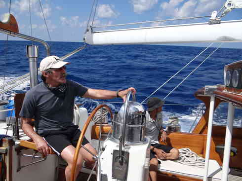 Geraldo at the helm of Voyager, with Larry at the ready.  Taken during the Marion to Bermuda sailing race, 2013.