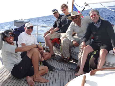 The crew of Voyager takes on moment on the aft deck.  From left is Larry, Guillermo, Greg, Forrest, Kevin, Geraldo.  Taken during the Marion to Bermuda sailing race, 2013.
