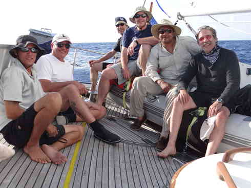The crew of Voyager takes a moment on the aft deck.  From left is Larry, Guillermo, Greg, Ross, Kevin, Geraldo.  Taken during the 2013 Marion to Bermuda sailing race.